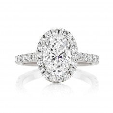 Oval Cut Engagement Ring With Seamless Claw Set Halo