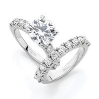 Round Brilliant Solitaire with claw set band
